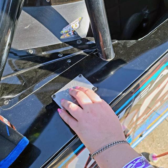 Finger reading braille racecar nameplate