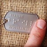 Finger reading Braille Dog Tag (Instagram)