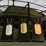 Gold, Silver, and Bronze award Dogtags on Display Stands (Instagram)