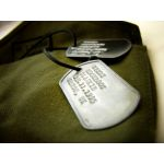 Rusty Steel Dog Tag debossed with green canvas sac