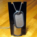 US Army Dog Tags on display stand