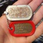 Rusty Steel Dog Tag with diver information